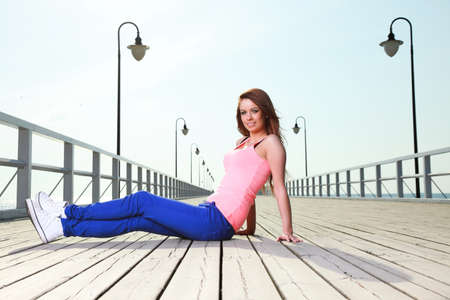 Attractive girl Young woman on pier Sits Relaxing Old Wooden Pier Stock Photo - 16237710