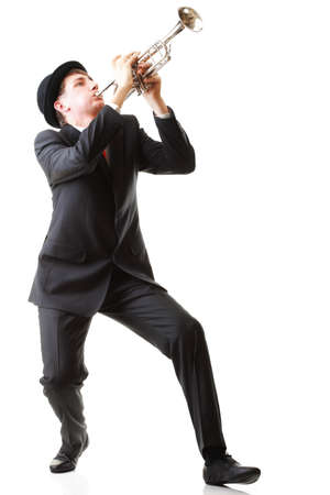 Portrait of a young man playing his Trumpet plays isolated white background Standard-Bild