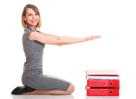 woman Overworked businesswoman holding plenty of documents isolated white red folder Stock Photo - 17391170