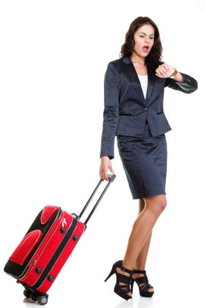 Full length of young business woman to late pulling red travel bag clock isolated on white background Stock Photo - 17391193