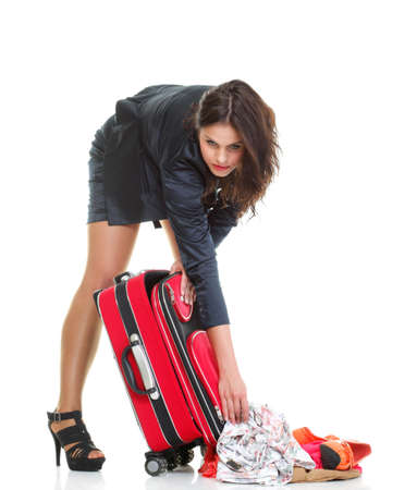 mishap: Full length of young business woman to late mishap misadventure pulling red travel bag clock isolated on white background