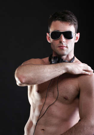 handsome man listening to music on headphone black background Stock Photo - 17390974