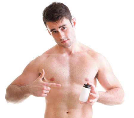 Athletic sexy male body builder holding a boxes with supplements on his biceps, man holding bottle of pills photo