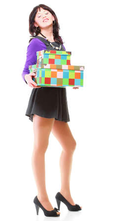 Woman carrying moving boxes. Young woman moving house to new home holding cardboard boxes isolated on white background standing in full length Stock Photo - 17391010