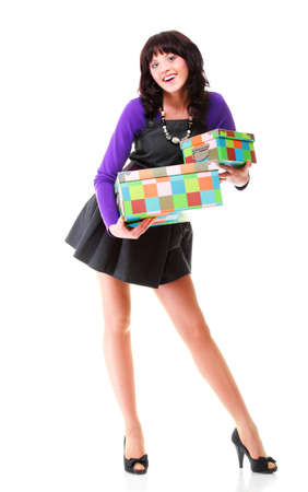 Woman carrying moving boxes. Young woman moving house to new home holding cardboard boxes isolated on white background standing in full length Stock Photo - 17391044