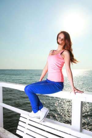 Attractive girl Young woman looking on background of sea sky Stock Photo - 18060002