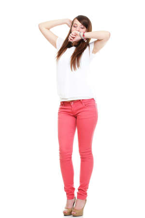 Beautiful standing yawning stretching woman in red Studio shot. Stock Photo - 18059856