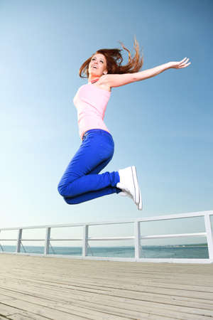 Attractive girl Young woman jumping in the sky Stock Photo - 18471535