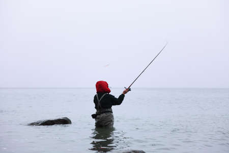 Fisherman in sea water autumn outdoor relax photo