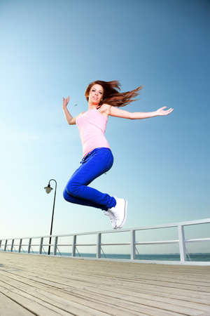 Attractive girl Young woman jumping in the sky Stock Photo - 18482777
