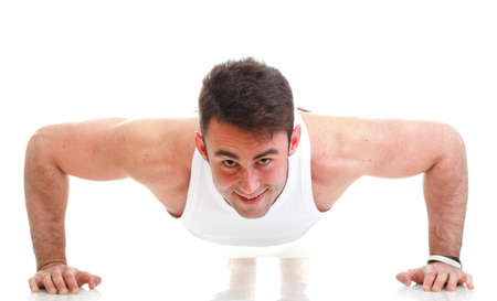 Sexy Young fashion sport man, fitness muscle model guy making push ups exercise white background photo