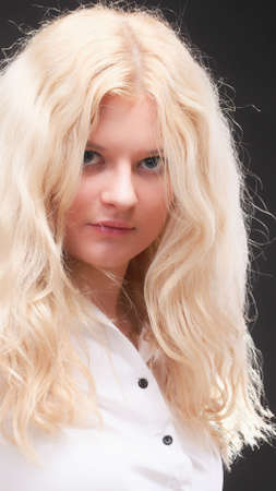 portrait of beautiful blonde woman black background photo