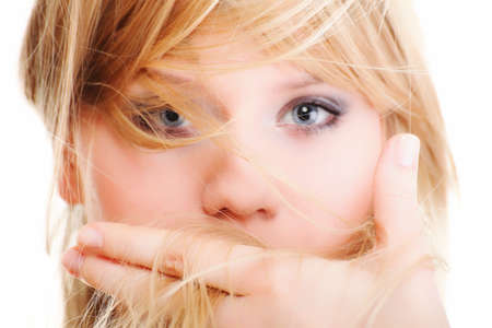 Beautiful woman blonde framing her face with her hands isolated blue eye long blond hair photo