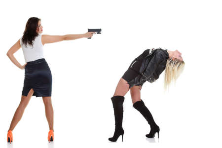 Woman with pistol pointing on her head isolated on white photo