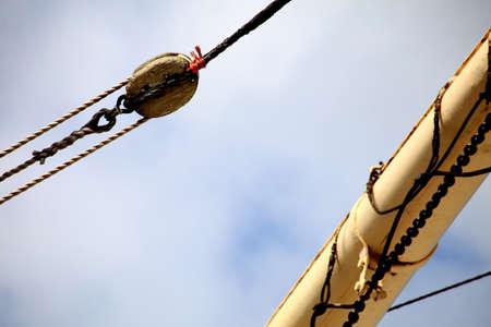 cordage: Masts and rope of sailing ship old boat detail