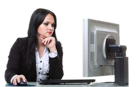 modern business woman sitting at office desk photo