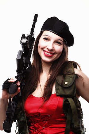 Sexy women - Girl holding an Assault Rifle, islated on white background photo