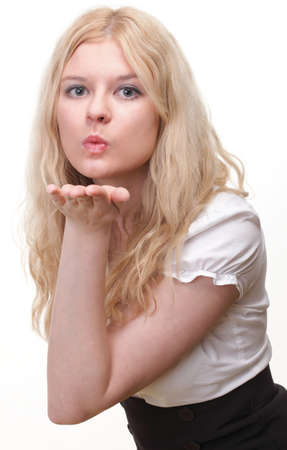 beautiful young blonde woman blowing a kiss photo