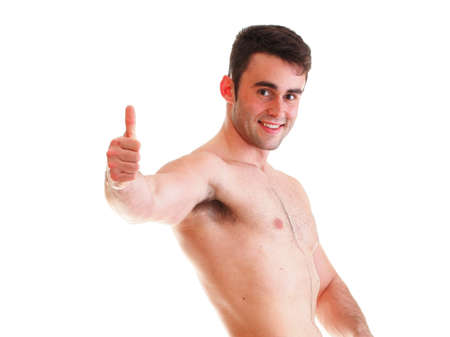 fatter: A muscular man showing how much weight he lost thumb up Stock Photo