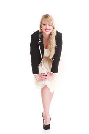Cute elegant woman in black dress having fun, isolated on white background photo