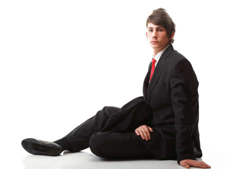 Fashion young businessman black suit casual red tie on isolated white background photo