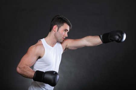 Portrait sportsman boxer in studio against dark background photo
