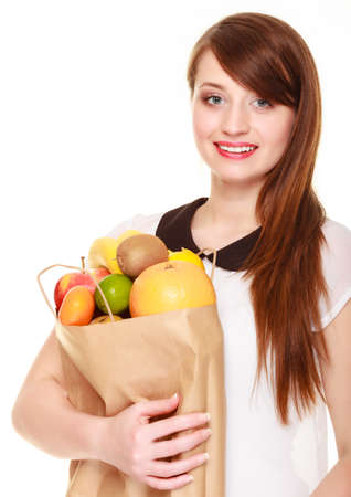 happy client: Woman girl happy client holding recycling paper shopping bag with fresh fruits isolated on white Stock Photo