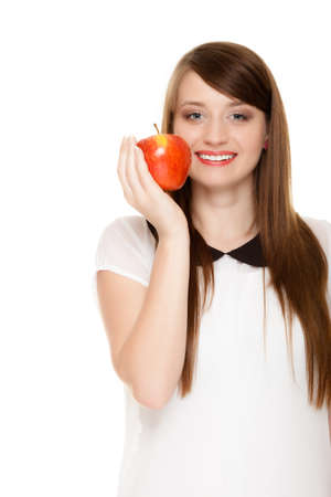 recommending: Diet and nutrition  Happy young woman offering apple seasonal fruit isolated on white  Girl recommending healthy lifestyle