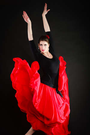 Art. Sexy spanish girl attractive woman in red long skirt dancing flamenco traditional dance. photo