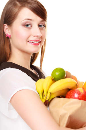 happy client: Grocery shop. Woman girl happy client holding recycling paper shopping bag with fresh fruits isolated on white. Healthy food.