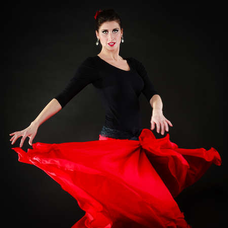 long skirt: Art. Sexy spanish girl attractive woman in red long skirt dancing flamenco traditional dance.