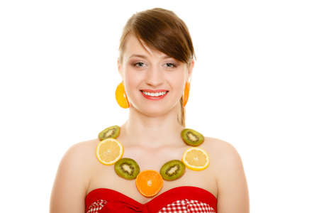 recommending: Diet. Happy girl with necklace and earrings of fresh citrus fruits isolated on white. Young woman recommending healthy food and nutrition.