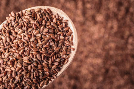 brown flax: Healthy food diet. Closeup brown flax seeds linseed on wooden spoon
