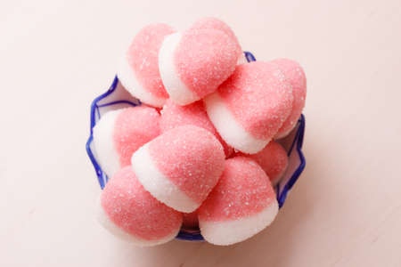 yummy: Sweet food candy. Pink jellies or marshmallows with sugar in bowl on wooden table