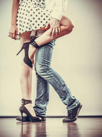 Young happy couple retro style dancing studio shot on gray Archivio Fotografico