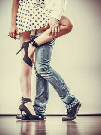ballroom dancing: Young happy couple retro style dancing studio shot on gray Stock Photo