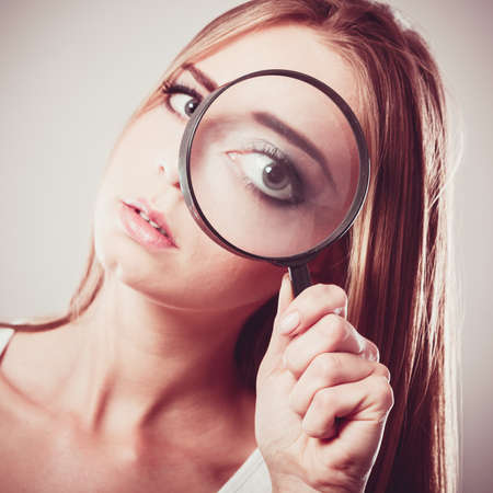 lupa: Investigation exploration education concept. Closeup woman face, girl holding on eye magnifying glass loupe