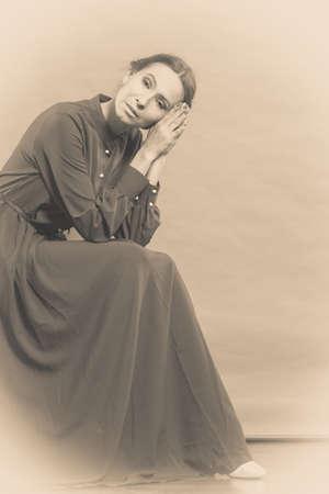 woman middle age: Sad woman retro style portrait long dark gown, vintage photo sepia toned Stock Photo