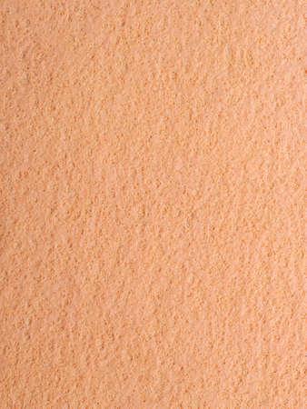 leathery: Macro bright orange chamois rough texture background Stock Photo