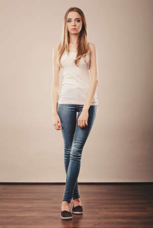 jeans: Young woman teenage girl in full length wearing denim trousers white blank top casual style Stock Photo