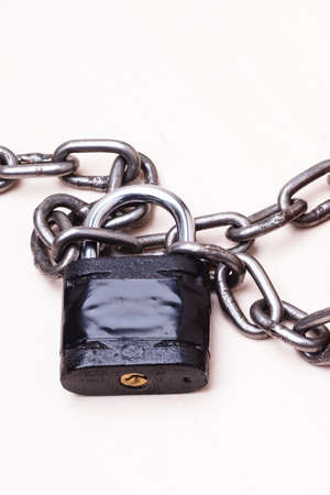 iron chain: Security concept. Black padlock and iron chain.