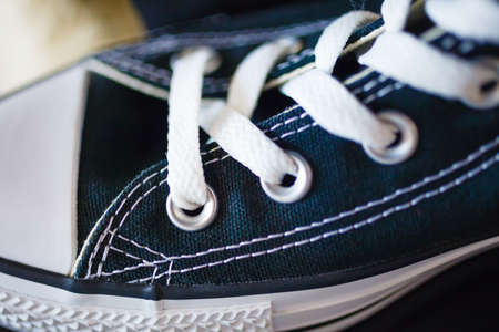 plimsoll: Sport fashion. Closeup navy blue fashionable sneakers on shop shelf Stock Photo