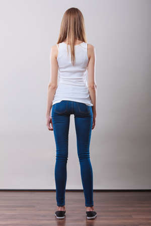 denim trousers: Woman full length in denim trousers white blank top back view