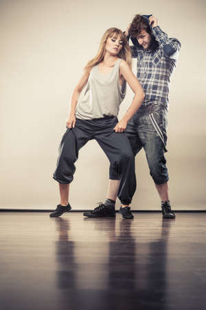 young girl: Two modern dancers couple woman and man dancing. Urban lifestyle. Hip-hop generation.