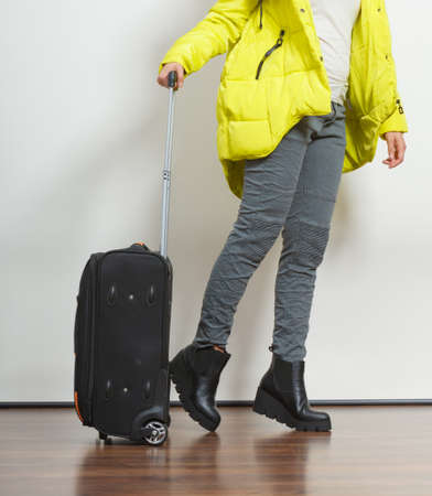 warm jacket: Woman in warm jacket with suitcase. Tourist travel girl. Tourism.