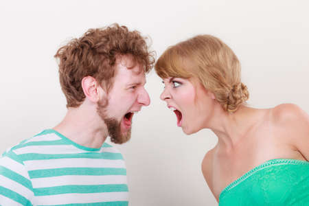 relationship difficulties: relationship difficulties. Angry woman and man yelling at each other. Face to face.