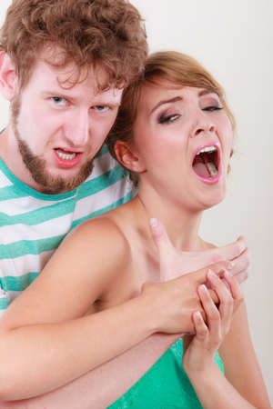 aggression: relationship difficulties. Aggression in family violence problem. Angry man strangling screaming woman