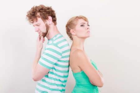 impasse: Bad relationship concept. Man and woman in disagreement. Young couple after quarrel offended back to back, not speaking to each other