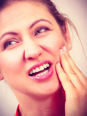 tooth pain: Mature woman female suffering from toothache tooth pain.