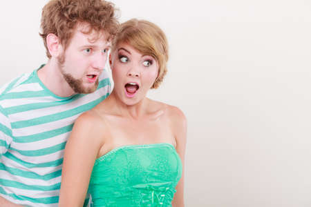 wide eyed: Emotional facial expression wide eyed couple, woman an man looking surprised open mouth